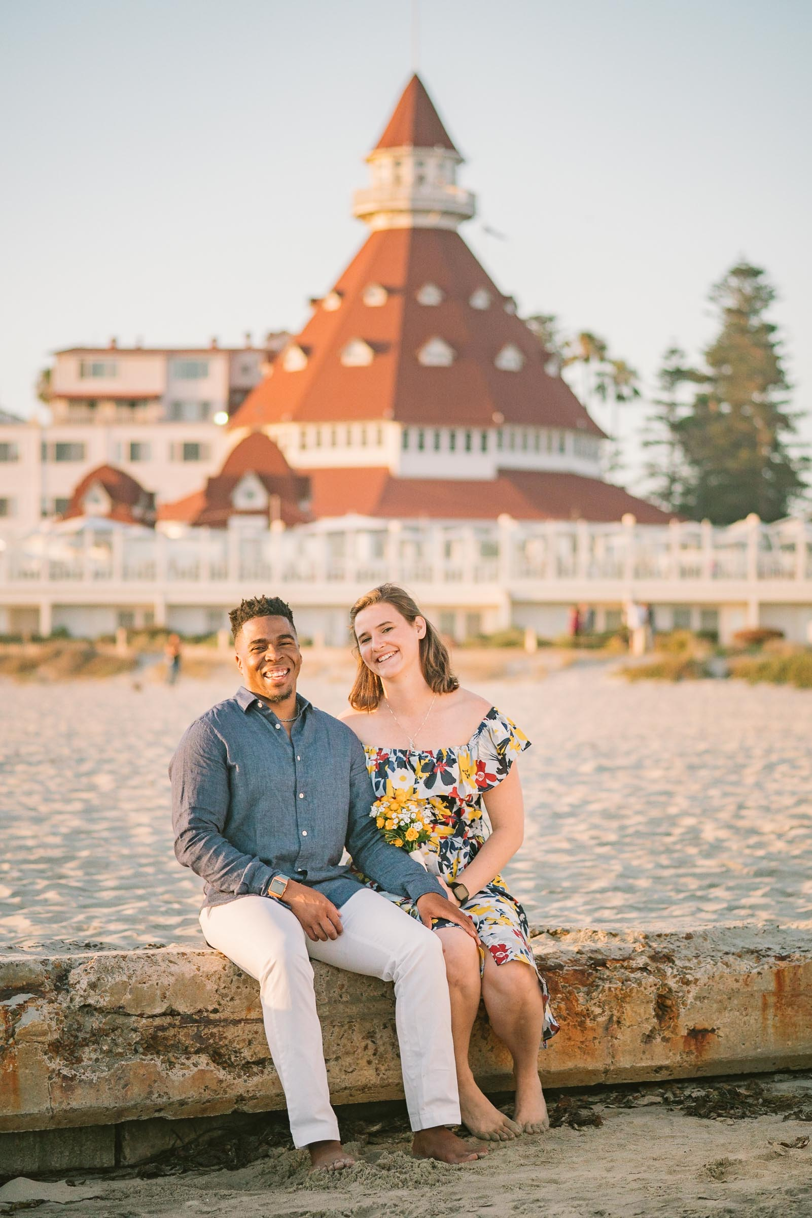 engagement session coronado island hotel sunset san diego california white girl yellow blue red dress african american interracial couple dusk