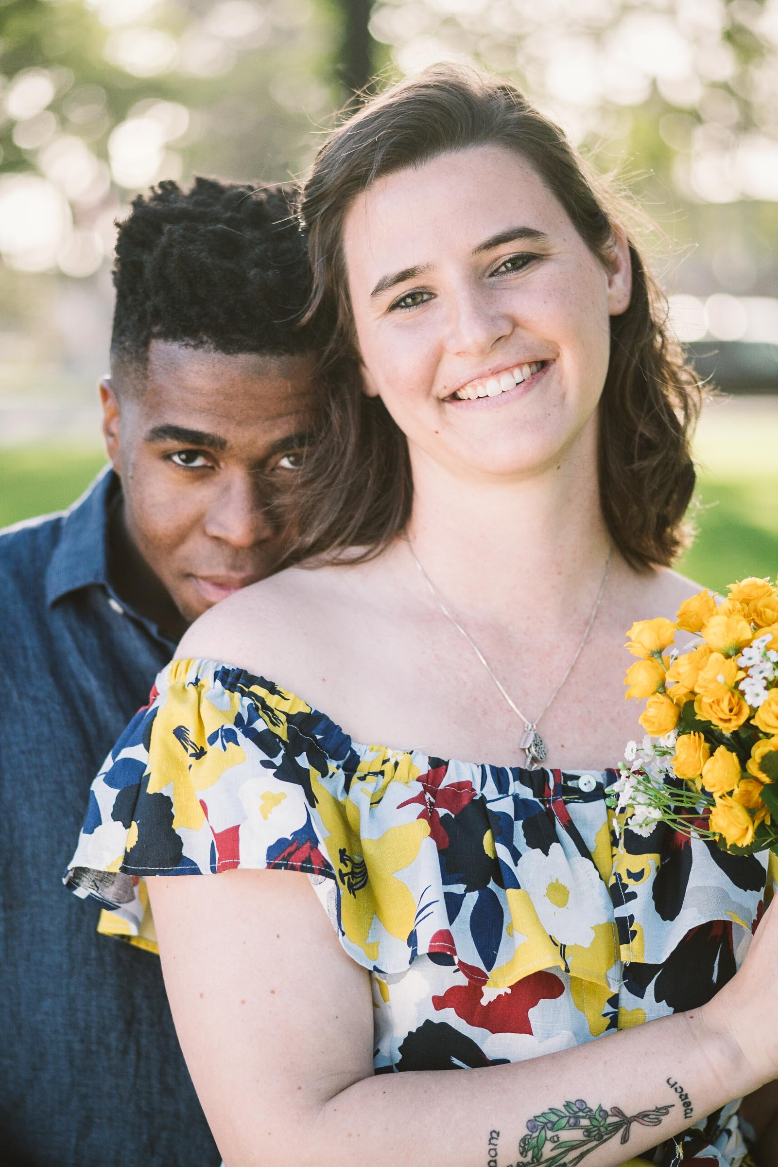 engagement session coronado island sunset san diego california white girl yellow blue red dress african american interracial couple spreckles park portrait