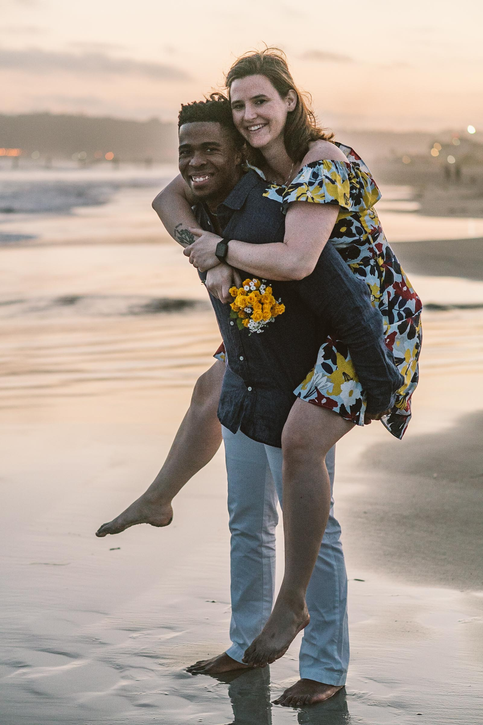 engagement session coronado island sunset san diego california white girl yellow flowers blue red dress african american interracial couple dusk