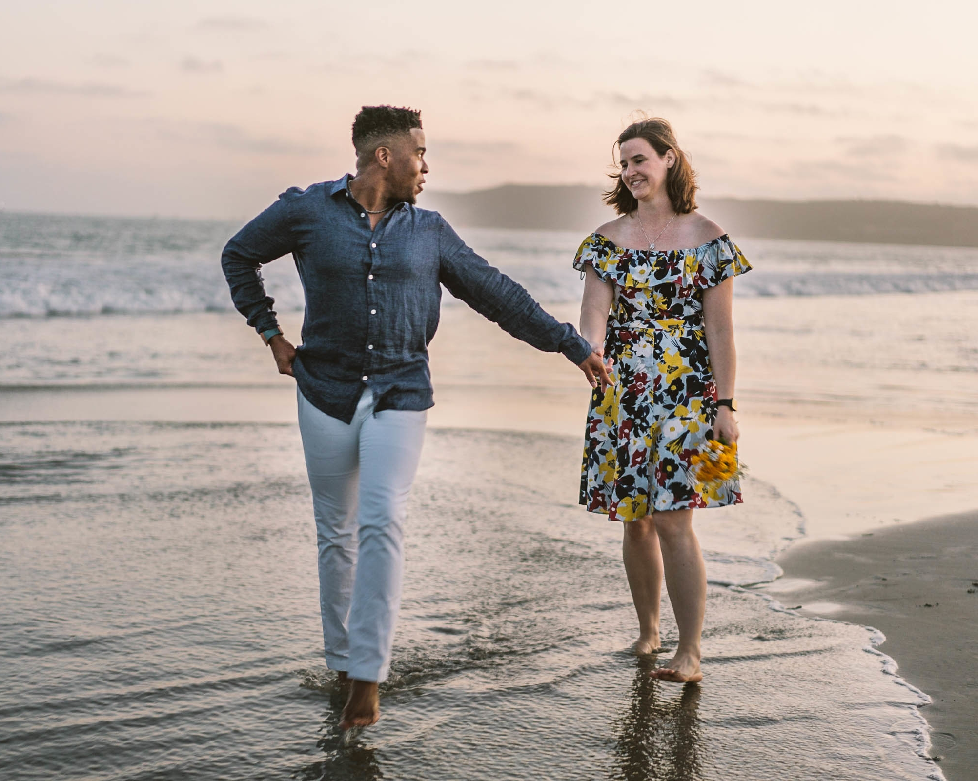 Engagement session san diego coronado island interracial couple beach sunset