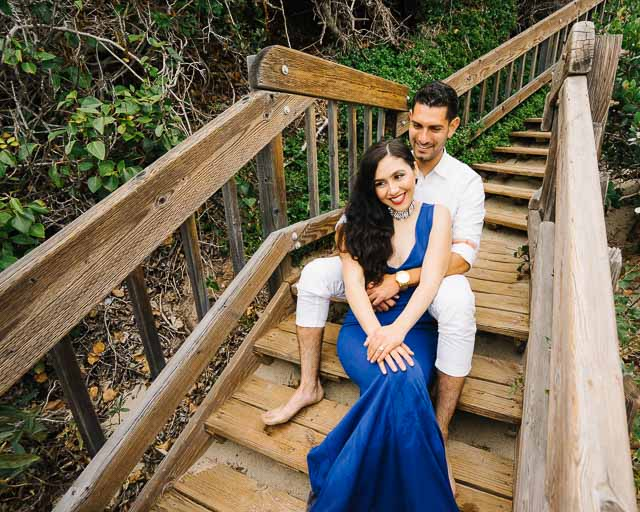 engagements portfolio orange county laguna beach victoria beach latino couple smiling stairs