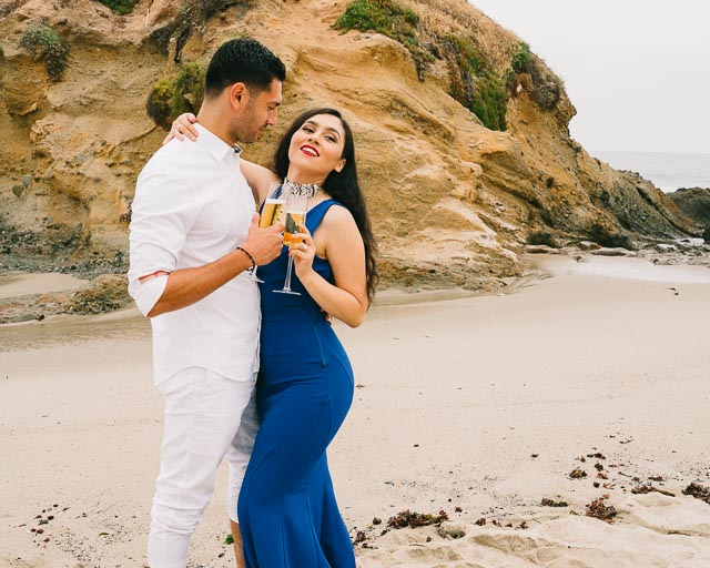 engagements portfolio orange county laguna beach victoria beach latino couple toasting champagne