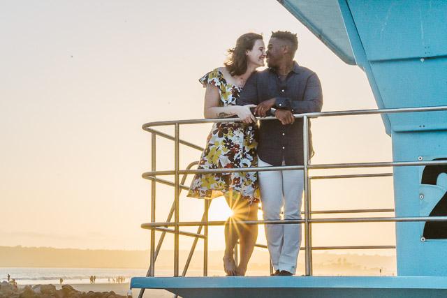 engagements portfolio san diego coronado island beach sunset interracial couple life guard tower