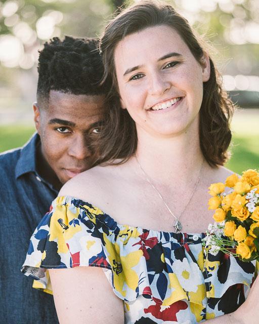 engagements portfolio san diego coronado island spreckels park interracial couple black white yellow flowers dress